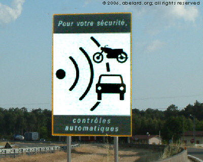 French road sign warning of a speed camera ahead, now being withdrawn