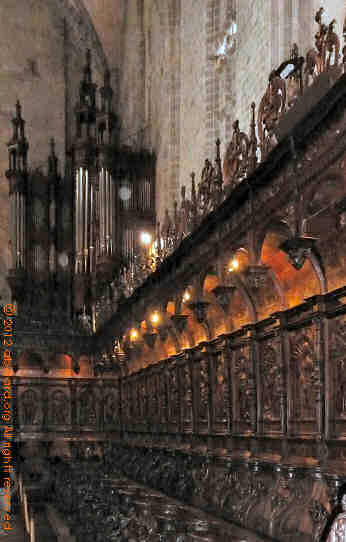 Part of the choir and its stalls, with the organ behind