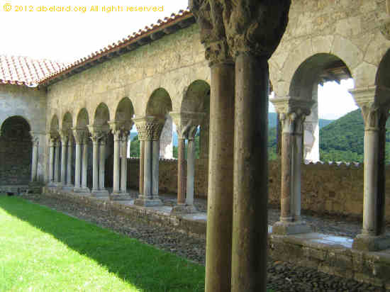 The Romanesque cloisters overlook the lower slopes of the Pyrenees