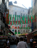 Bayonne pedestrianised shopping street, with banners in Basque colours (red and green)