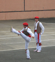 Basque dancer doing a high kick.