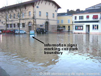 A town car park next to the flooded River Midouze