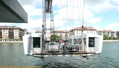 the gondola carries cars, cyclists and foot passengers