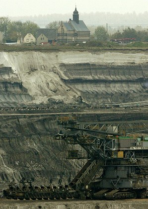 Strip mining almost reaching the medieval chuch. Image credit: Reuters.