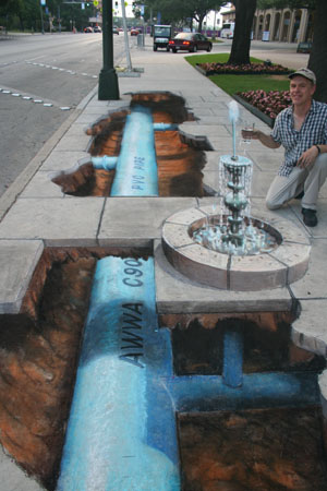 A fountain in the street, produced by Julian Beever