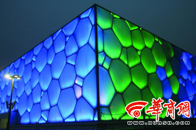 The Water Cube lit up at night. Credit: Huashang newspaper