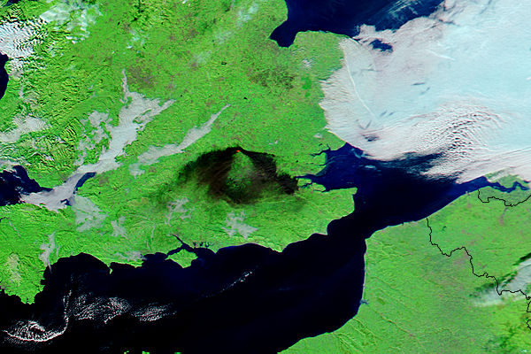 Smoke from oil depot fire at Hemel Hempstead, England. Image courtesy of NASA.
