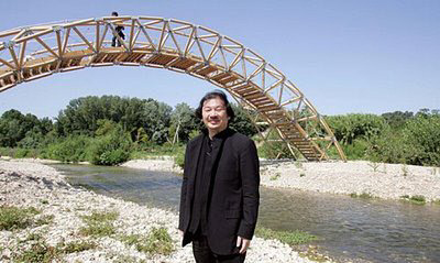 Shigeru Ban in front of his 'paper' bridge close to the Roman Pont de Gard, France. Image source:  France 24.com