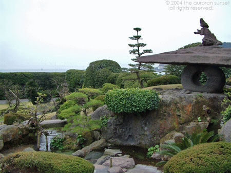 Looking over the garden, out to sea, at Senganen (Iso Gardens). Image credit: the auroran sunset