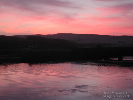 Pink sky and water. Image credit: abelard