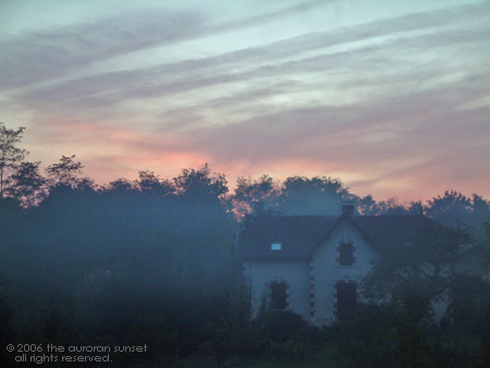 House in set in a misty sunset sky. Image credit: the auroran sunset