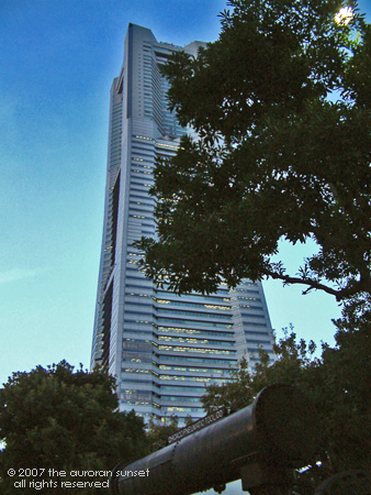 The Landmark Tower seen from below through a tree. Yokohama, Tokyo, Japan. Image credit: abelard.org